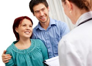 Couple speaking to fertility consultant